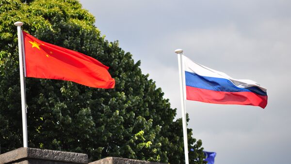Speaking to China National Radio on Sunday, Renmin University Professor Jin Canrong explained Russia and China's common positions regarding the Second World War, noting that the Chinese leadership's participation in May's victory celebrations in Moscow signifies the high level of Russian-Chinese relations. - Sputnik International