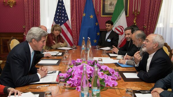 U.S. Secretary of State John Kerry holds a meeting with Iran's Foreign Minister Mohammad Javad Zarif over Iran's nuclear program, in Lausanne, Switzerland, Wednesday March 18. - Sputnik International