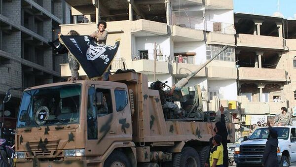 Fighters from the al-Qaida linked Islamic State of Iraq and the Levant (ISIL) during a parade in Raqqa, Syria - Sputnik International