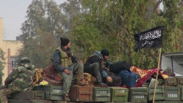 Rebels from al-Qaida affiliated al-Nusra Front, as they sit on a truck full of ammunition, at Taftanaz air base, that was captured by the rebels, in Idlib province, northern Syria - Sputnik International