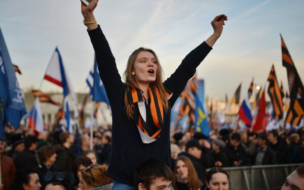 Rally and concert on Vasilyevsky Slope to mark anniversary of Crimea's reunification with Russia - Sputnik International