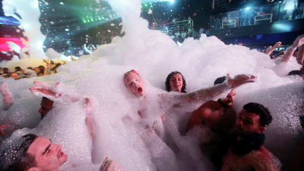 Partygoers dance in foam at The City nightclub in the Caribbean resort city of Cancun, Mexico, early Monday, March 16, 2015 - Sputnik International