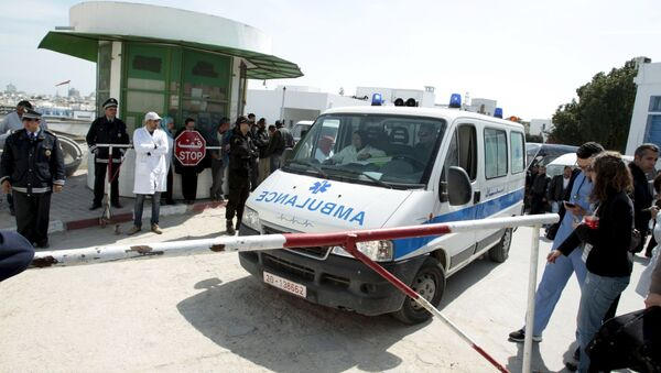 An ambulance arrives at the morgue carrying the body of a victim of Wednesday's attack on the national museum in Tunisia, in Tunis March 19, 2015 - Sputnik International
