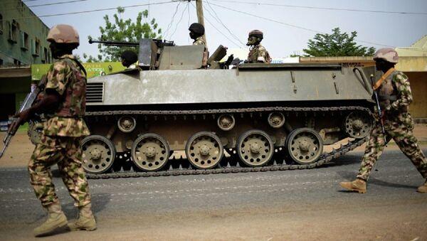 Nigerian troops patrol in the north-eastern Nigerian city of Mubi, some 20 kms (14 miles) west of the Cameroon border - Sputnik International