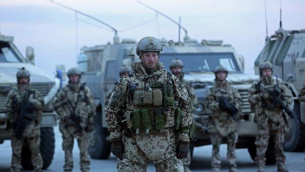 German soldiers stand guard during the NATO Secretary-General Jens Stoltenberg's visit, 2014. - Sputnik International