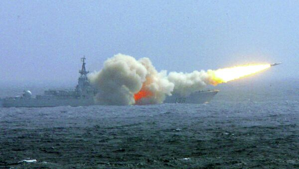 A destroyer of the South China Sea Fleet of the Chinese Navy fires a missile during a training exercise. - Sputnik International
