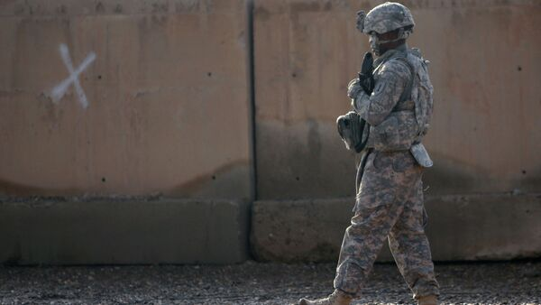 A US soldier walks at the Taji base complex which hosts Iraqi and US troops and is located thirty kilometres north of the capital Baghdad - Sputnik International