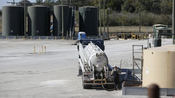 In this Wednesday, Nov. 19, 2014 photo, a fracking wastewater storage facility sits just outside the city limits of Reno, Texas - Sputnik International