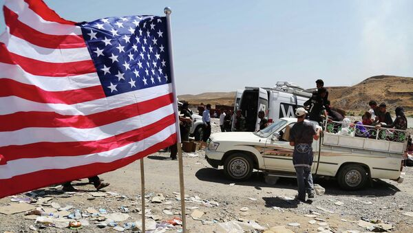 US flag waves while displaced Iraqis from the Yazidi community cross the Syria-Iraq border on Feeshkhabour bridge over Tigris River at Feeshkhabour border point, northern Iraq - Sputnik International