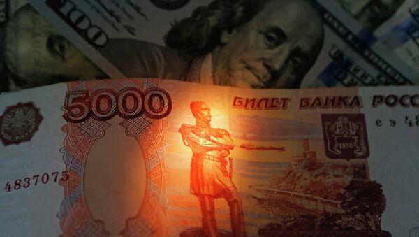 Banknotes of US dollars and rubles - Sputnik International
