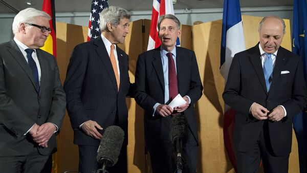 German Foreign Minister Frank Walter Steinmeier (L), U.S. Secretary of State John Kerry (2nd L), British Foreign Secretary Philip Hammond and French Foreign Minister Laurent Fabius (R) talk after Secretary Hammond made a statement about their meeting regarding recent negotiations with Iran over Iran's nuclear program in London, England March 21, 2015 - Sputnik International