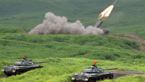 Japan Ground Self Defense Forces' type 92 anti-landmine missile fires while 74 tanks standing by during an exercise in its Higashi-Fuji training ground in Gotemba - Sputnik International