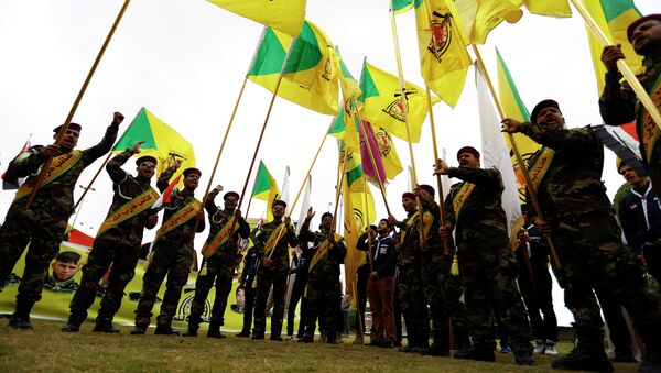 Members of the Hezbollah Brigade in Iraq, a Shiite movement supporting the Iraqi government forces in the ongoing clashes against Daesh (ISIS) terrorists - Sputnik International