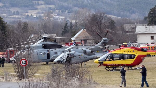 Helicopters of the French Air Force (back) and civil security services are seen in Seyne, south-eastern France, on March 24, 2015, near the site where a Germanwings Airbus A320 crashed in the French Alps. - Sputnik International
