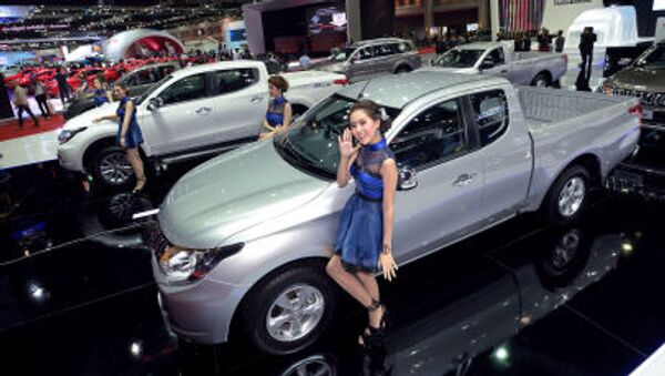 Models pose next to cars displayed at the 36th Bangkok International Motor Show on March 24, 2015 - Sputnik International
