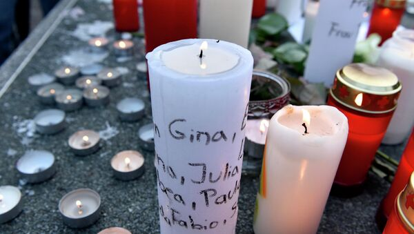 Candles with names of crash victims written on it are placed a table tennis table in front of the Joseph-Koenig Gymnasium in Haltern, western Germany. - Sputnik International