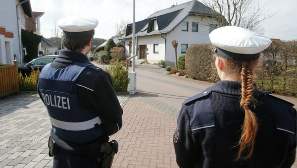 Police hold media away from the house where Andreas Lubitz lived in Montabaur, Germany. - Sputnik International