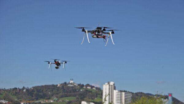 Drones performing surveillance tasks. - Sputnik International