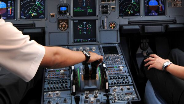 Pilots in the cockpit of an Airbus A320 at Cengkareng airport in Jakarta. File photo - Sputnik International