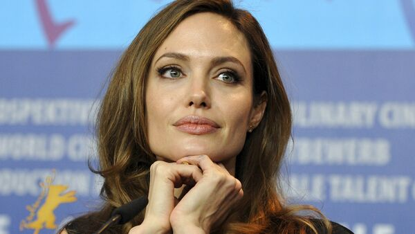 U.S. actress and director Angelina Jolie attends a news conference to promote the movie The Land Of Blood And Honey at the 62nd Berlinale International Film Festival in Berlin in this February 11, 2012 file photo - Sputnik International
