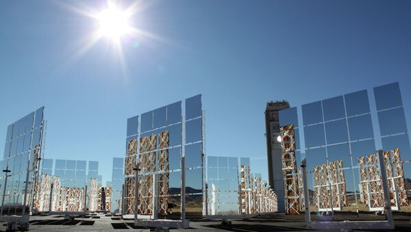 The sun shines above the field of mirrors that make up the National Solar Thermal Test Facility at Sandia National Laboratories in Albuquerque, New Mexico - Sputnik International