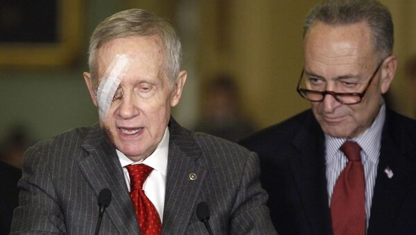 US Senate Minority Leader Harry Reid  (L) and Sen. Charles Schumer talk to the media after a weekly Senate party caucus luncheon on Capitol Hill in Washington, in this February 10, 2015 - Sputnik International