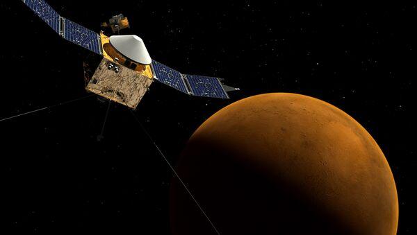 This artist's concept shows the MAVEN spacecraft orbiting Mars. - Sputnik International