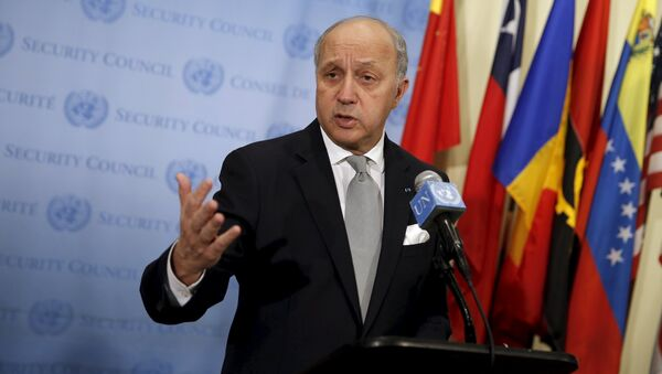 French Foreign Minister Laurent Fabius speaks to members of the media as he stands outside the United Nations Security Council chambers - Sputnik International