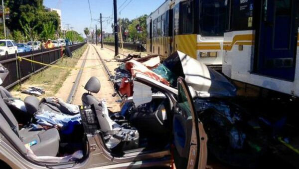 A car and metro link train collided near the USC campus in Los Angeles, Calif., March 28, 2015 - Sputnik International