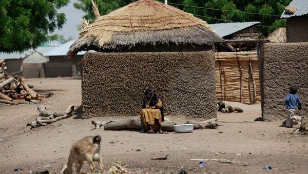 Woman sits outside her home in Chibok, Borno - Sputnik International