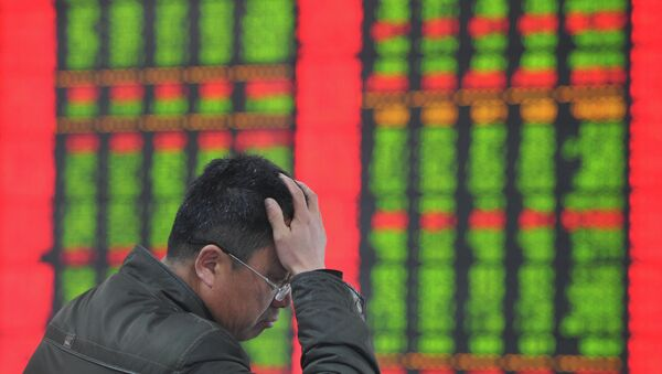 A stock investor gestures as he checks share prices at a securities firm in Fuyang, east China's Anhui province - Sputnik International