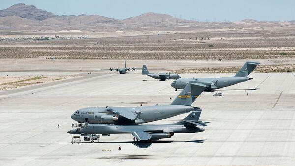 Several C-17 Globemaster IIIs, C-130 Hercules and a B-1 Lancer park on the flightline May 31, 2013, at Nellis Air Force Base, Nev - Sputnik International