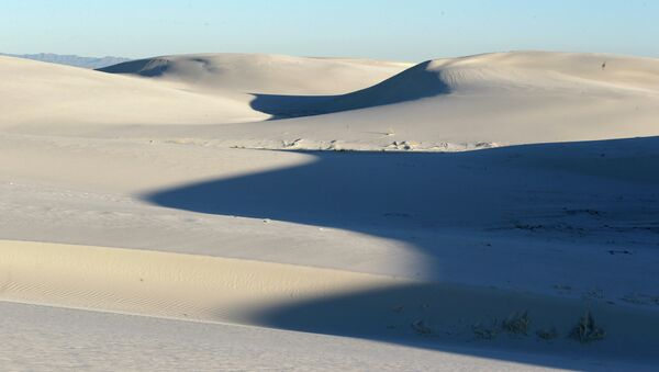 The sun sets over sand dunes, Thursday, March 5, 2015, in White Sands National Monument, N.M. - Sputnik International