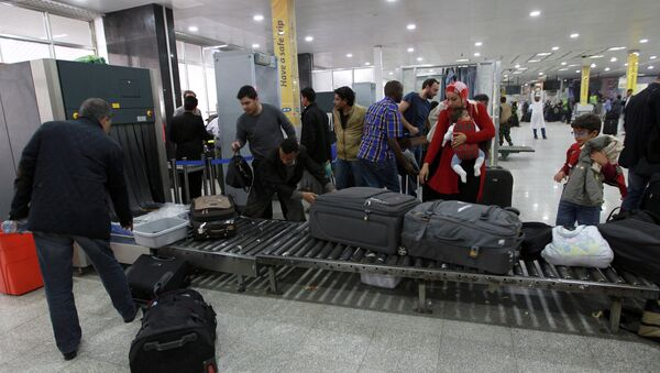 Travelers pass through security at Sanaa International Airport as hundreds of foreigners were evacuated from the Yemeni capital due to security reasons on March 28, 2015 - Sputnik International