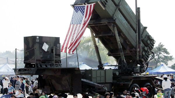South Korean visitors shelter from the sun under the shadow of a U.S. Surface-to Air missile Patriot launcher during Air Power Day at the U.S. airbase in Osan, south of Seoul, South Korea - Sputnik International