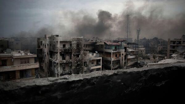In this Tuesday, Oct. 2, 2012 file photo, smoke rises over Saif Al Dawla district in Aleppo, Syria. - Sputnik International