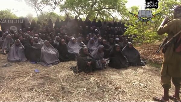 This Monday, May 12, 2014, file image taken from video by Nigeria's Boko Haram terrorist network, shows the alleged missing girls abducted from the northeastern town of Chibok. Islamic extremists in Nigeria have seized Chibok, forcing thousands of residents to flee the northeastern town from which the insurgents kidnapped nearly 300 schoolgirls in April. - Sputnik International