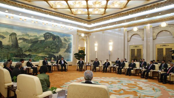 Chinese President Xi Jinping meets with guests of the Asian Infrastructure Investment Bank at the Great Hall of the People in Beijing - Sputnik International