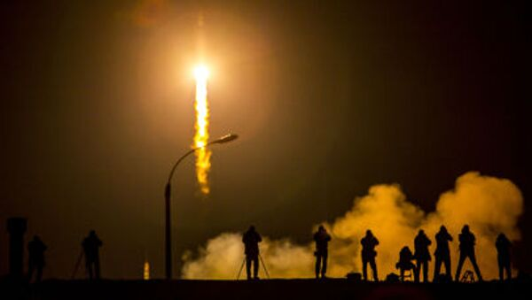 Media photograph the Soyuz TMA-16M spacecraft is seen as it launches to the International Space Station with Expedition 43 NASA Astronaut Scott Kelly, Russian Cosmonauts Mikhail Kornienko, and Gennady Padalka of the Russian Federal Space Agency (Roscosmos) onboard Saturday, March 28, 2015, Kazakh time (March 27 Eastern time) from the Baikonur Cosmodrome in Kazakhstan. As the one-year crew, Kelly and Kornienko will return to Earth on Soyuz TMA-18M in March 2016 - Sputnik International