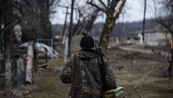 Independence supporter  walks along their position at the frontline in a village not far form Luhasnk, eastern Ukraine, Thursday, March 12, 2015 - Sputnik International