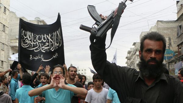 Supporters of the Al Nusra Front take part in a protest against Syrian President Bashar al-Assad and the international coalition in Aleppo on September 26, 2014 - Sputnik International