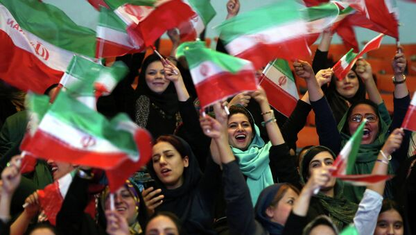 Iranian women wave Iranian flags during a ceremony of farewell for their national soccer team ahead of the 2014 World Cup in Brazil - Sputnik International