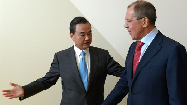 Russian Foreign Minister Sergey Lavrov, right, and Foreign Minister of China Wang Yi meeting during the Ministerial Week of the 68th session of the UN General Assembly - Sputnik International