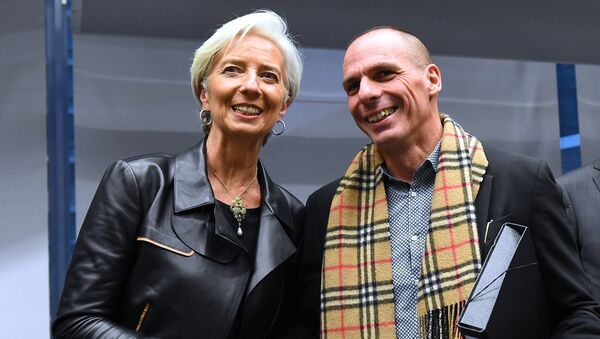 Greek Finance Minister Yanis Varoufakis (R) shakes hands with International Monetary Fund (IMF) Director Christine Lagarde during an emergency Eurogroup finance ministers meeting at the European Council in Brussels on February 11, 2015 - Sputnik International