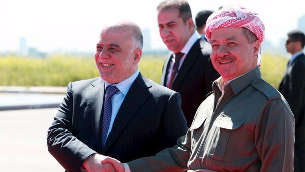 Iraqi Kurdish regional President Massoud Barzani (R) shakes hands with Iraqi Prime Minister Haider al-Abadi at Arbil International Airport April 6, 2015 - Sputnik International