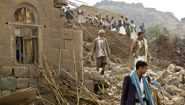 In this Saturday, April 4, 2015 file photo, Yemenis stand amid the rubble of houses destroyed by Saudi-led airstrikes in a village near Sanaa, Yemen - Sputnik International
