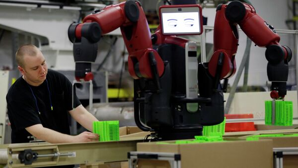 A technician works with Baxter, an adaptive manufacturing robot created by Rethink Robotics at The Rodon Group manufacturing facility, Tuesday, March 12, 2013, in Hatfield, Pa. - Sputnik International