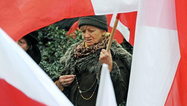 A woman seen between Polish national flags - Sputnik International