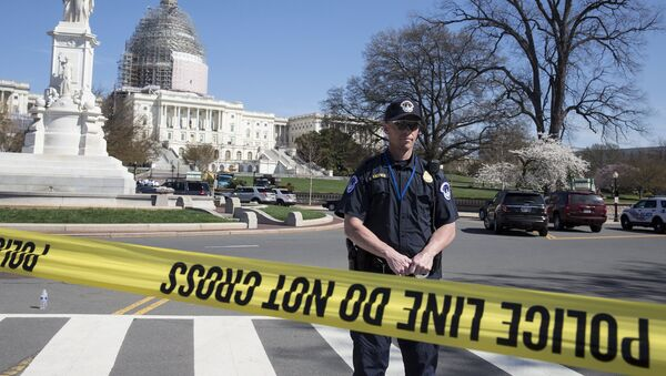 Police guard the U.S. Capitol grounds after a shooting took place, in Washington April 11, 2015 - Sputnik International