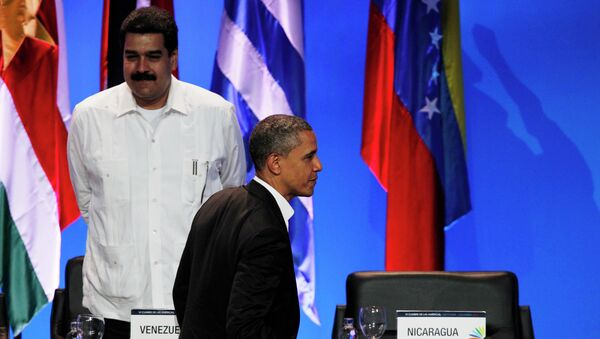 President Barack Obama walks past the empty seat of Nicaragua as he leaves the opening ceremony of the sixth Summit of the Americas after shaking hands with Venezuela's Prime Minister Nicolas Maduro, left, in Cartagena, Colombia, Saturday April 14, 2012 - Sputnik International